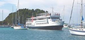 Ferry weaving between yachts